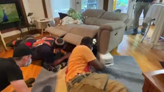 Firefighters Rescue Dog Trapped in Recliner