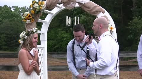 Groom sings 'All Of Me' to bride at their wedding