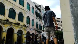 People In The Street Crossing Old Buildings