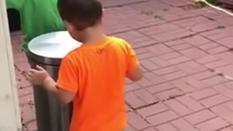 Kids Jokingly Hit Each Other With Trash Can's Lid by Stepping on It's Pedal