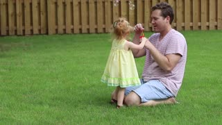 a dad play with his young daughter