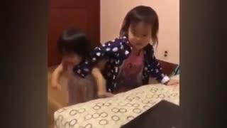 Little girl copy her sister