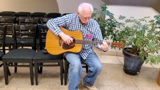 Dad playing Martin Guitar owned by Hank Williams Sr