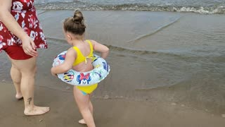 My Daughter scared of the ocean waves
