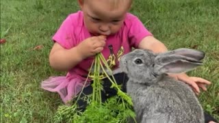 Sharing a carrot with her bunny