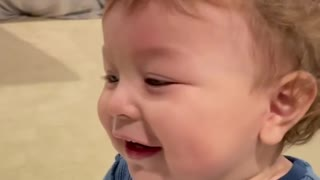 Baby has the time of his life saying the world ''circle''