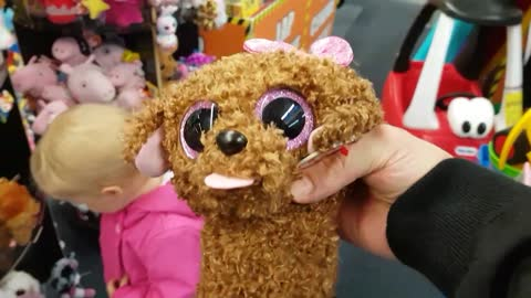 Baby Adorably Reacts to Stuffed Animals at the Toy Store