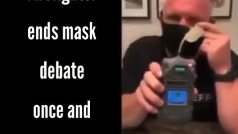 Firefighter demonstrates oxygen-deprevation using face masks