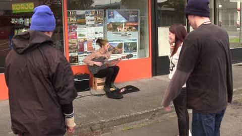 Girl Busker gets her guitar broken