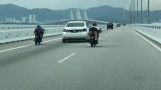 Malaysian Motorists Perform Group Stunt over Penang Bridge