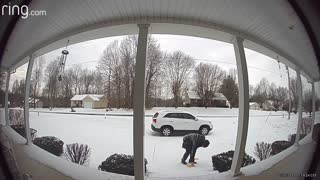 Man Slips Down Icy Front Porch Steps