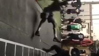 Guy wearing cleats slips on floor during football practice