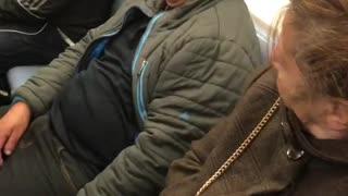 Green jacket yellow beanie man falling asleep on woman