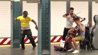 Man in yellow dances to classical music