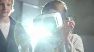 A girl wearing a Virtual Reality headset