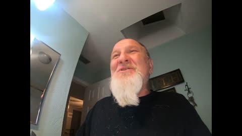 Shaving off the beard.