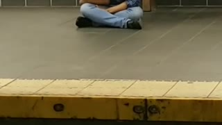 Blue flannel subway station sitting face down
