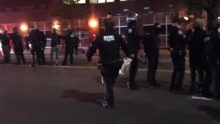 NYPD line up arrested rioters.