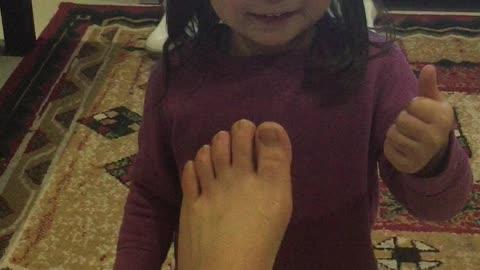 3 year-old girl having fun massage Mummy's feet