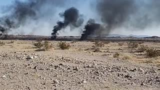 Aftermath of Military Jet Slamming into Ground