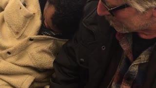 Stranger falls asleep on man's shoulder on bus ride