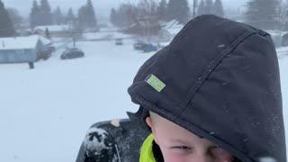Sledding in Montana During Snow Storm