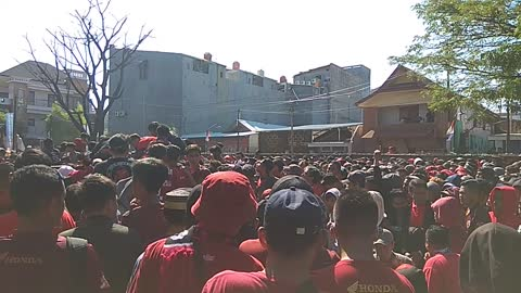 Hundreds of soccer supporters cramped in front of the entry gate