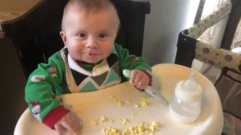 Cute baby eating baby leo