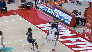 Unbelievable. Basketball player pukes on opponent.