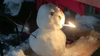 Snowman smoking candle