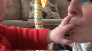 Baby plays and scratches moms lips