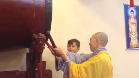Boy drumming at Buddhist Temple