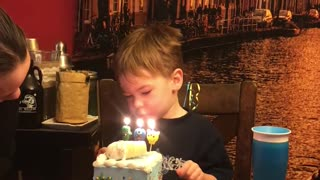 Kid Doesn't Understand Concept Of Blowing Out Birthday Candles