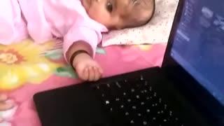 Sarah playing with laptop