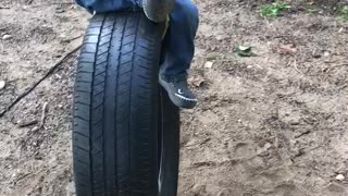 Ashers first swing on tire swing