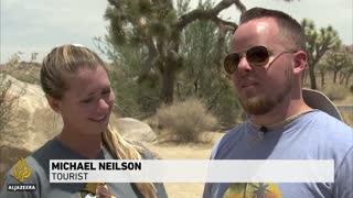 California battles wildfire as blazing heat hits western US