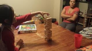 Daughter Falls Playing Jenga
