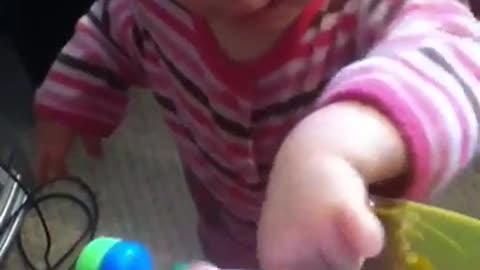 Emma playing baby