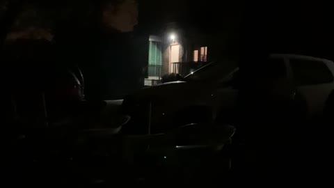 Old man walking in the dark