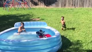 Funny kids playing with water