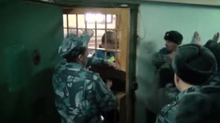Russian Prison Guards Filmed Punching Inmates