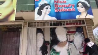 Afghanistan under Taliban Sharia Rules - Women's Uncovered Faces Removed from City Walls