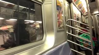 Woman sings loudly in subway train, recorder laughs