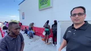 Border Patrol Dropping Off Haitians at a Bus Stop