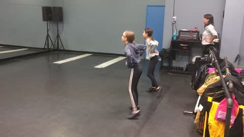 Macey and Sophie tap dancing