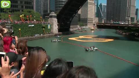 More than 60,000 rubber ducks set sail down the Chicago
