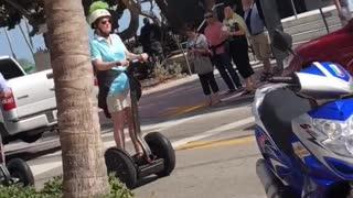 Weekend u old people ride segways down sidewalk