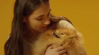 Woman holding cute puppy