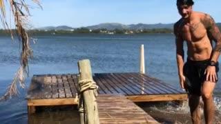 Dog Trips Friend Running onto Pier