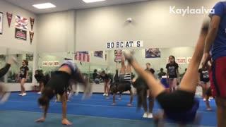 Gymnastics girls do back flip, girl in front lands on her head